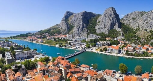 See the rugged cliffs over Omis on your trip to Croatia