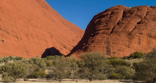 Experience the Uluru outback where the native people of Australia used to live on your Australia Vacation