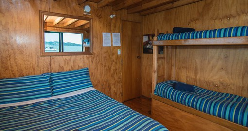 Stay in one of the 3 Bed Cabins onboard the Rock Cruise Ship as a New Zealand vacation package