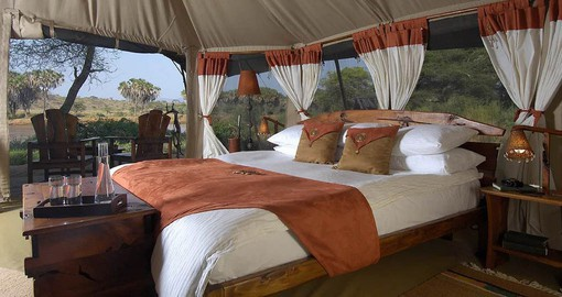 Elephant Bedroom Camp's spacious tents have rustic and colourful African touches