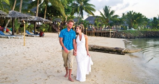 Couple walking on the beaches of Samoa