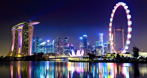 Singapore city skyline at night - always a highlight when on a Singapore vacation.