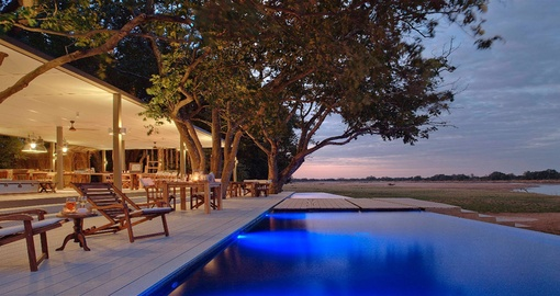 Have a magical dinner on the Luangwa on your next trip to Zambia.
