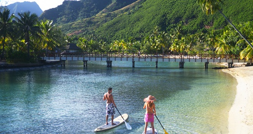 Couple stand up paddling in Moorea