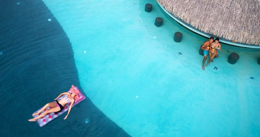 Enjoying the swim-up bar at Manava Suites Tahiti
