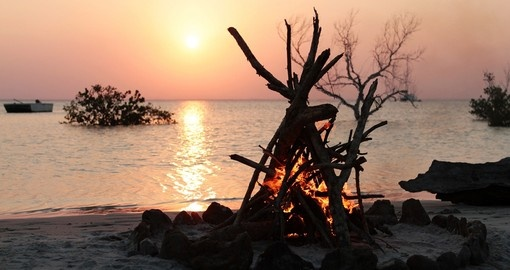 A campfire on the tropical beach of Bazaruto Island is a great romantic getaway on your Mozambique vacation