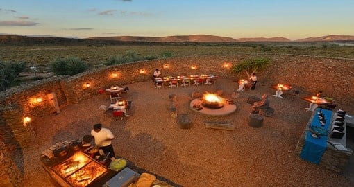 Enjoy a delicious boma dinner at the Gondwana Family Lodge during your South Africa trip.