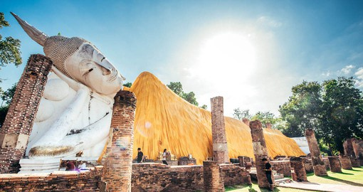 Visit the Buddha statue at temple of Ayutthaya as part of your Thailand Vacation.