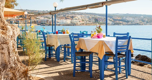 Enjoy a lunch overlooking the Mediterranean on your trip to Greece
