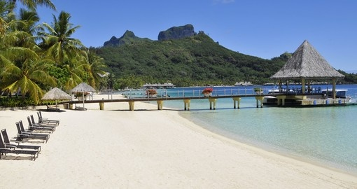White powder sand beach at Intercontinental Le Moana Bora Bora with a view of Mount Otemanu