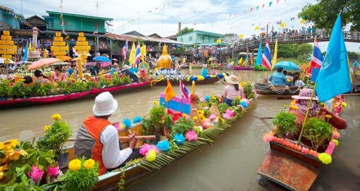 Float through the market on your Thailand vacation