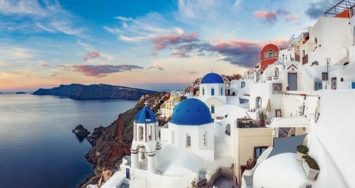 Volcanic sand beaches and dazzling panoramas make Santorini the model of the Greek Isles