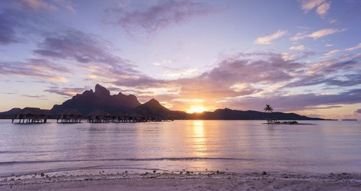 Enjoy the romantic sunset over Bora Bora on your next Bora Bora vacations.