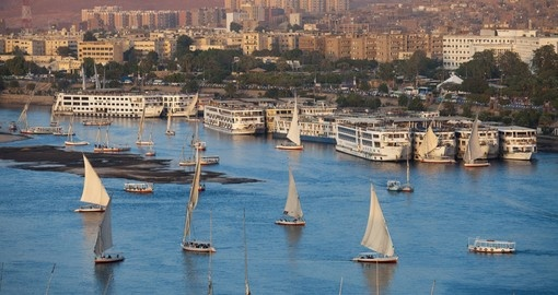 Explore the city of Aswan with felucca boats on the Nile during your next Egypt tours.