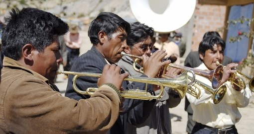 Aymara musicians play their trumpets at the festival Morenada