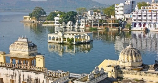 Experience Beautiful buildings on a lake in Udaipur during your India vacations.