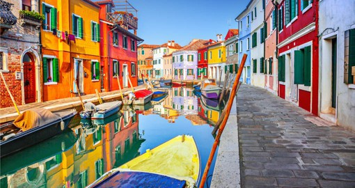 Burano is known for its small, brightly painted houses which are popular with artists