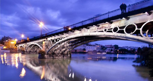 Cross the Triana Bridge, the oldest in Seville on your trip to Spain