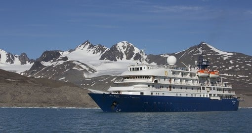 Embark on the Ocean Adventurer and travel throughout the Arctic on your Arctic Circle Travel