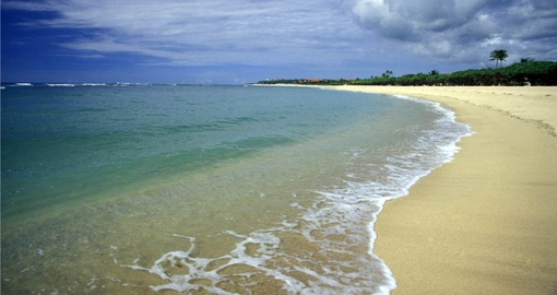 Stroll along the beach on your Bali vacation