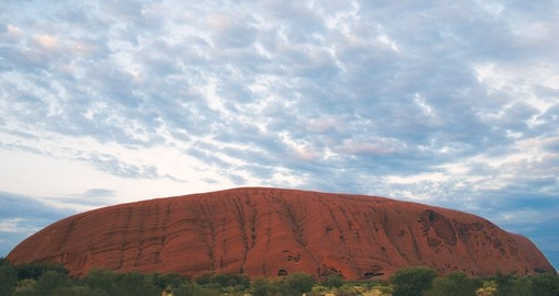 Visit Uluru and watch sunrise during your next Australia Vacations.
