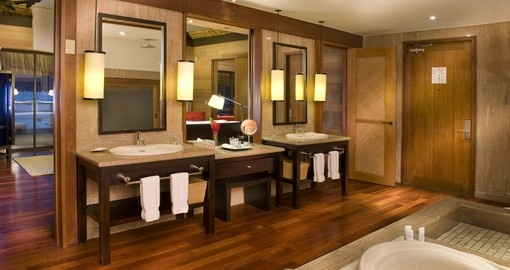 Pristine bathrooms and high quality furniture are a guarantee at the St. Regis Bora Bora during your Tahiti Vacations.