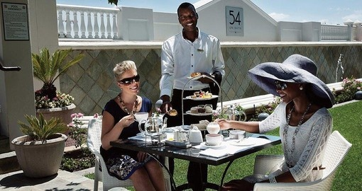 Dine on the terrace at 54 On Bath during your South African trip.