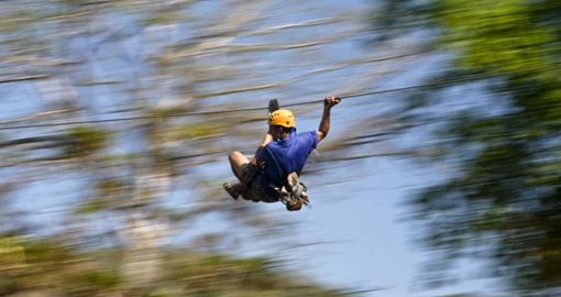 Zip through the forest on a Green Canopy Tour of Los Suenos on your Costa Rica Vacation