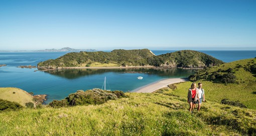 Trek up the hillside of Cape Reinga and enjoy the beautiful scenery on your New Zealand Vacation.