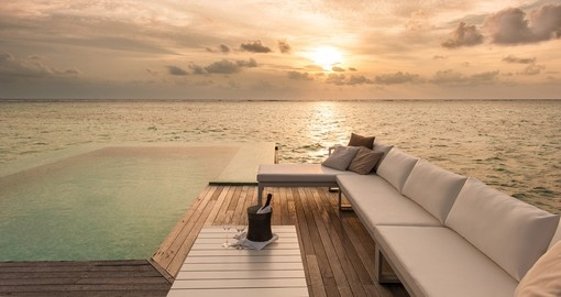 Experience the sunset while you sip on a bottle of champagne on your Trip to Maldives