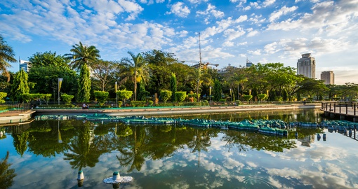 Walk through Rizal Park, which is surrounded by local fauna and has a pond located in the middle on your Philippines Vacation