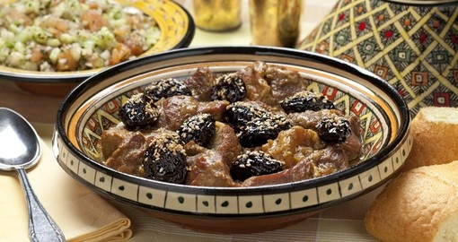 Moroccan dish with meat plums and sesame seeds