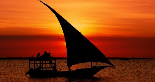 Travel to Mozambique and see the fishermen dhow at sunset