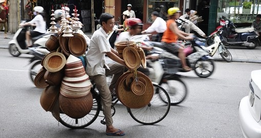 A hat salesman in the busy Hanoi traffic