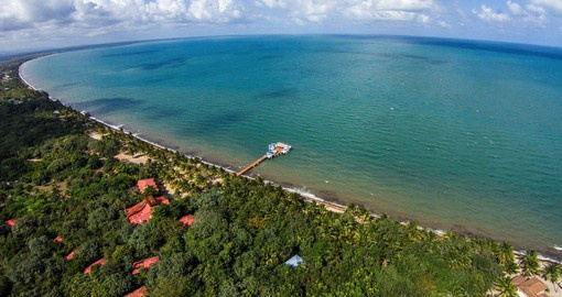 On the shores of the Caribbean, Hamanasi Resort is the perfect spot to stay on a trip to Belize