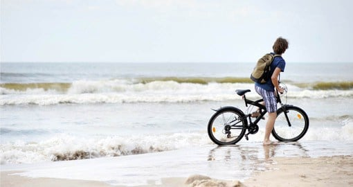 Enjoy biking along the coat of the Baltic Sea on your Europe tour package