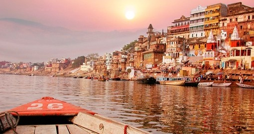 Sunsets over the river bank on the Ganges River is an ideal photo opportunity on India tours.