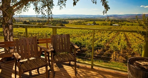 Enjoy beautiful view of Yarra Valley vineyard from a porch during your next Australia vacations.