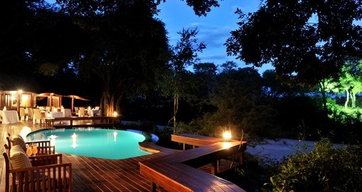 Take a dip in the pool at the Imbali Safari Lodge during your South Africa vacation.