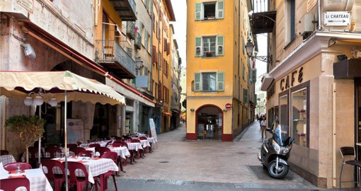 Take a walk on the colorful streets of Nice on your next trip to France.