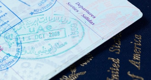 Visa and immigration stamps in US passport for Dubai or Abu Dhabi