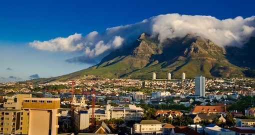 Begin your South African vacation in Cape Town framed by Table Mountain and The Devil's Peak