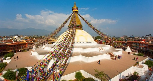 Trek up the tree dotted mountain side along Kathmandu and visit the Boudhanath Stupa to learn about the religious practices of the region on your Nepal Vacations