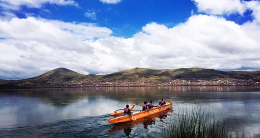 Paddle along Lake Titicaca during your Peru vacation.