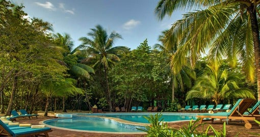 Time to relax by the pool at Hamanasi during your trip to Belize