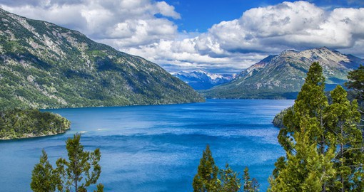 The crystal-clear blue waters of glacial Lake Nahuel Huapi  cover and area of 338 square kilometers