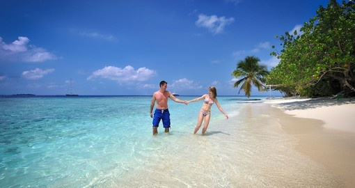 On you Trip to Maldives, experience what it feels like to relax on a pristine beach surrounded on all sides by water