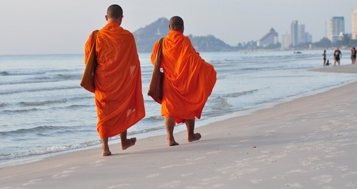 Two monks take a walk on the beach