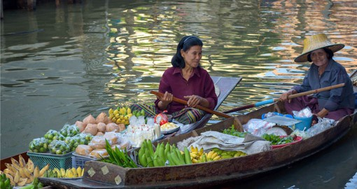 Take a stroll throughout the Floating Market on your trip to Thailand