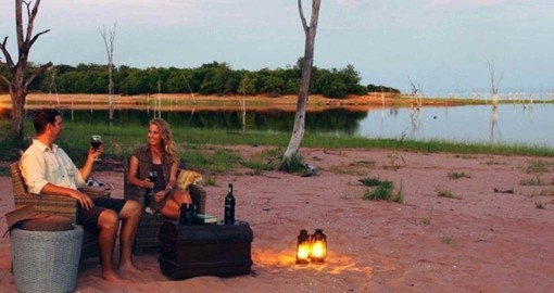 Dine on the beach at Lake Kariba during your travel to Zimbabwe